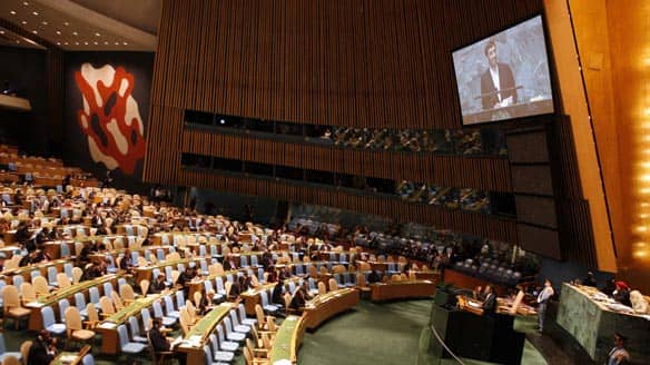 Iranian President Mahmoud Ahmadinejad speaks to a nearly empty room at the United Nations headquarters after several nations, including Canada, walked out in protest of the speech on Wednesday.