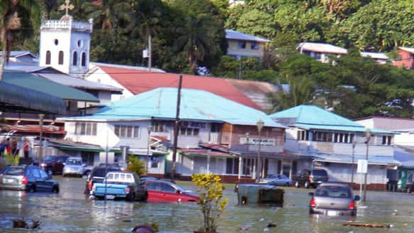 A main road in the downtown area of Fagatogo, in American Samoa, is seen flooded by water from a tsunami on Tuesday.