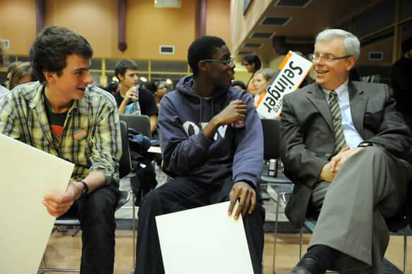 Manitoba NDP leadership hopeful Greg Selinger shares a laugh with two young NDP party members prior to their voting at a delegate meeting of youth party members in Winnipeg Tuesday.