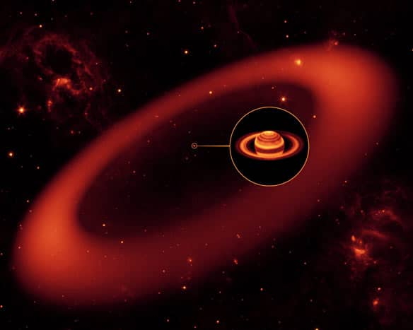 This artist's rendering shows the biggest ring around Saturn, spotted by NASA's Spitzer Space Telescope. The inset shows an enlarged image of Saturn, as seen by the W.M. Keck Observatory at Mauna Kea, Hawaii, in infrared light.