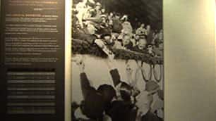 A photograph at the Vancouver exhibit shows Canadian athletes holding up autograph books to a smiling Adolf Hitler.