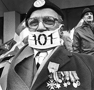 An unidentified war veteran demonstrates outside the Montreal offices of the Quebec government's language commission in 1987. Bill 101 and subsequent legislation have stirred passions and protests in Quebec - both for and against the laws.