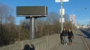 The first of six billboards has been erected by the Squamish First Nation beside the Burrard Bridge on reserve land.