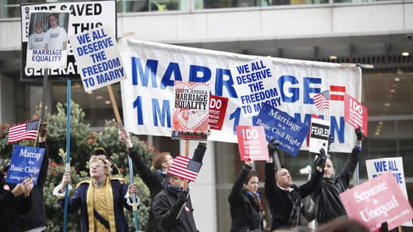 Demonstrators for and against same-sex marriage hold signs during a rally in front of a federal courthouse in San Francisco on Monday.  (Paul Sakuma/Associated Press)