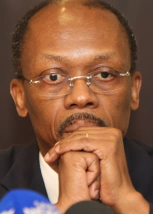 Twice deposed former Haitian president Jean-Bertrand Aristide, at a press conference in Johannesburg on Jan. 15, 2010. Ready to go home to help if allowed. (Associated Press)