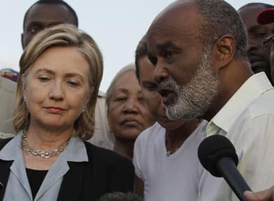 Haitian President Rene Preval at an impromptu press conference with U.S. Secretary of State Hillary Clinton in Port-au-Prince on Jan. 16, 2010, four days after the earthquake. (Associated Press)