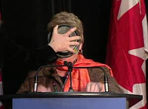 A woman apparently protesting the seal hunt pushes a pie into the face of federal Fisheries Minister Gail Shea, seen here in an image captured on video.
