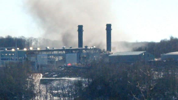 Smoke rises from the Kleen Energy plant in Middletown, Conn., on Sunday after an explosion that officials said killed at least five people and injured at least 12 others.