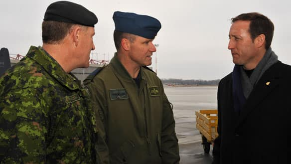Col. Russell Williams, centre, speaks to Chief of Defence Staff Gen. Walter Natynczyk, left, and Defence Minister Peter MacKay during a visit to CFB Trenton on Jan. 17.
