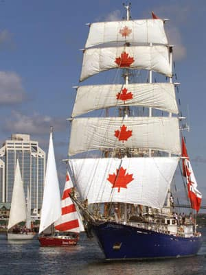 The Canadian tall ship SV Concordia, a sailing school vessel, heads past downtown Halifax in this July 24, 2000 file photo.