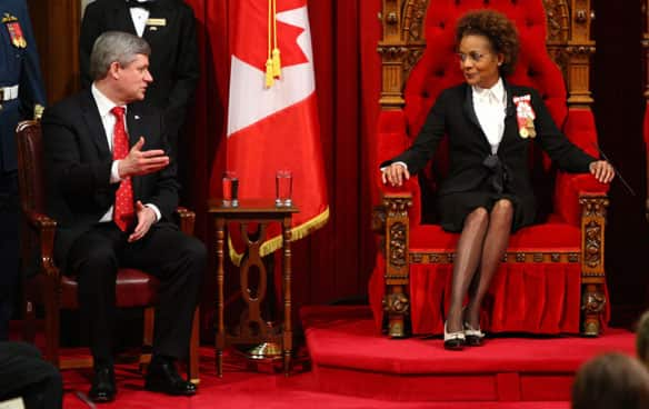 Gov. Gen. Michaëlle Jean speaks with Prime Minister Stephen Harper before delivering the throne speech in the Senate in January.