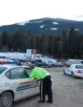 RCMP direct traffic at the staging area for avalanche search-and-rescue operations near Revelstoke on Saturday.