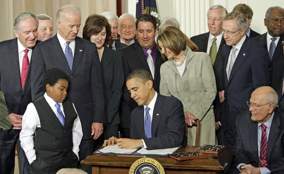 Obama+signing+the+health+care+bill