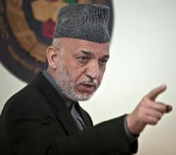 Hamid Karzai speaks at Afghanistan's Independent Election Commission in Kabul on April 1. The Afghan president has reportedly threatened to join the Taliban insurgency over Western pressure to implement reforms.