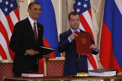U.S. President Barack Obama and his Russian counterpart, Dmitry  Medvedev, display their signatures on the new Strategic Arms Reduction  Treaty (START II) at Prague Castle on April 8, 2010. (Reuters)