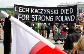 Supporters of the late Polish president hold a poster prior to a national memorial service in Pilsudski Square.