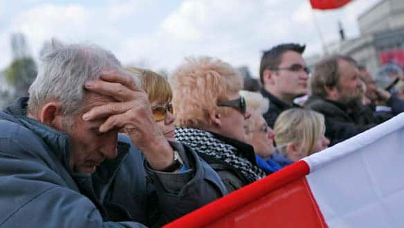 People attend a national memorial service in Warsaw's Pilsudski Square on Saturday.