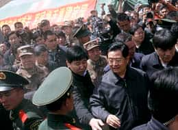 President Hu Jintao, centre right, is greeted by people upon his arrival in a temporary hospital in Jiegu on Sunday.