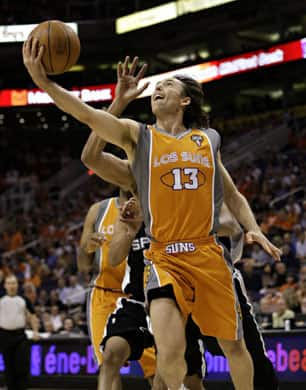 Phoenix Suns guard Steve Nash, wearing the Los Suns jersey, drives against the San Antonio Spurs during game two of the second-round playoff series on May 5. (Matt York/Associated Press)