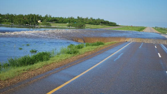A large hole has formed along the flooded portion of the Trans-Canada Highway in Saskatchewan.