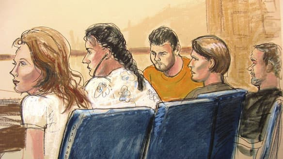 In this courtroom sketch, from left, Anna Chapman, Vicky Pelaez, the defendant known as Richard Murphy, the defendant known as Cynthia Murphy and the defendant known as Juan Lazaro are seen in Manhattan federal court in New York on Monday.