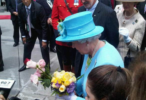 The Queen accepted dozens of bouquets from children and adults in a crowd waiting to see her Wednesday in Ottawa.