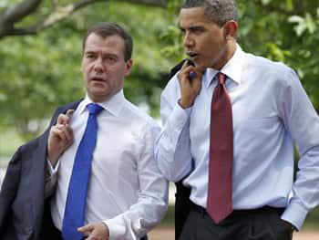 President Barack Obama and Russian President Dmitry Medvedev walk through Lafayette Park in Washington just days before the FBI announced the arrests of 10 alleged deep-cover Russian agents, who had been under suspician for years. (Scott Applewhite/Associated Press)