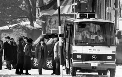 In this Feb. 11, 1986 file photo, unidentified people accused of spying for the West board a bus at the Glienicke bridge checkpoint between West Berlin and East Germany. Soviet Jewish dissident Anatoly B. Shcharansky was the first prisoner exchanged. (Heribert Proepper, Associated Press)