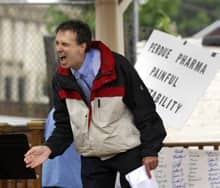 Larry Golbom of Clearwater, Fla., speaks passionately at a rally in Abingdon, Va., in 2007 about Oxycontin abuse. Heartache resulting from OxyContin overdoses prompted about 40 people to gather in pouring rain in Abingdon where the maker of the powerful painkiller and three current and former executives were to be sentenced for misleading the public about its risk of addiction. (AP Photo/Bristol Herald Courier, David Crigger)