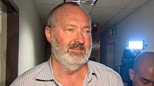 Actor Randy Quaid leaves an immigration hearing in Vancouver after saying he is seeking refugee status in Canada.