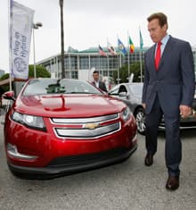California Gov. Arnold Schwarzenegger checks out the Chevrolet Volt electric car during a tour of the greenest vehicles at the Los Angeles Auto Show at the L.A. Convention Center on Nov. 19.