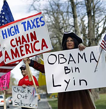 Tea Party activists in Smithtown, N.Y., take their anti-tax message to the streets in April 2010. (Reuters)
