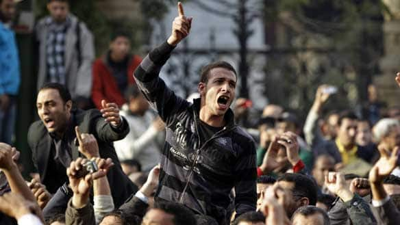 Angry Egyptian activist shouts at riot police outside the journalists' syndicate in downtown Cairo on Wednesday.  Read more: http://www.cbc.ca/world/story/2011/01/27/egypt-protest-cairo-mubarak.html#ixzz1CH9Mxqd2