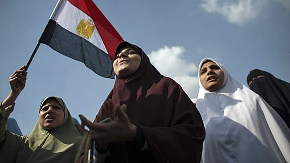 Anti-government protesters demonstrate in Tahrir Square, in Cairo on Tuesday.