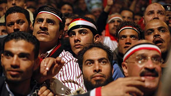 Opposition supporters wait for Egyptian President Hosni Mubarak's national address in Cairo's Tahrir Square Thursday night. When it came, the speech was a bitter disappointment to all those who have spent more than two weeks calling for Mubarak's resignation.