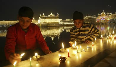 Sikh youth light oil lamps inside the complex of the holy Sikh shrine of the Golden Temple to mark the birth anniversary of Guru Gobind Singh, in Amritsar, India Jan. 11. Guru Gobind Singh, the tenth Sikh guru, declared wearing a kirpan a commitment of faith in 1699.