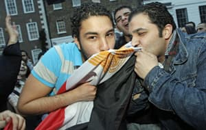 Egyptians and supporters celebrate the resignation of President Hosni Mubarak outside the country's embassy in London on Friday.