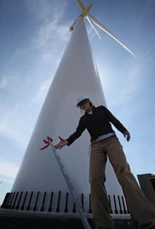 A worker underneath a turbine in Windy Point, Wash. on May 12, 2010. Judith Lipp from the Toronto Renewable Energy Cooperative says the green energy job sector will grow by more than 50 per cent by 2016.