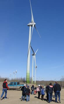 A group of school children visit the 34-turbine Bear Mountain wind farm in 2010. Developers say projects can spur hundreds of spinoff jobs for the local community.