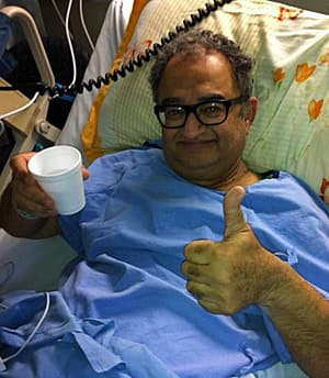 Author and activist Tarek Fatah in hospital in Toronto. (Natasha Fatah/CBC)