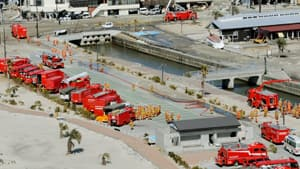 Fire trucks converge in preparation to spray water at the Fukushima Daiichi nuclear plant on Friday.