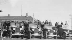 Trucks taking men to work for relief projects in Saskatchewan, 1934.