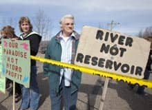 A small group of demonstrators stand at the airport in Hudson's Hope, B.C. on April 19, 2010 to oppose the Site C Clean Energy Project, a hydroelectric dam.
