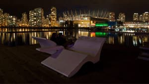 A couple eats dinner while taking in the view of downtown from southeast False Creek during Earth Hour in Vancouver in 2012.