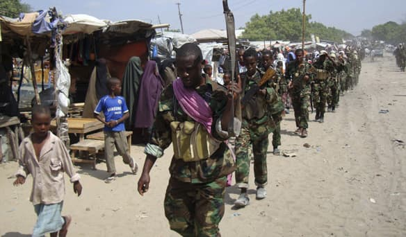 Members of the hardline al-Shabaab, an Islamist rebel group on Canada's terror list, parade through the outskirts of Somalia's capital Mogadishu, January 1, 2010. A man RCMP said was on his way to Somalia to join al-Shabaab was arrested in Toronto on March 29 on terrorism related charges.  Reuters