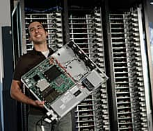 Facebook manager of hardware design Amir Michael holds a component from a data drive at Facebook headquarters in Palo Alto, Calif., Thursday, April 7, 2011.Facebook is making the blueprints and mechanical designs of its servers open source.(Marcio Jose Sanchez/Associated Press)