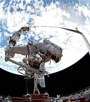 The space shuttle Canadarms have been used to support astronauts on spacewalks, like this one to service the Hubble telescope in 1993.