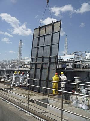 A steel fence is installed to cover a gate to prevent the spread of radioactive water at an intake canal at the Fukushima Daiichi nuclear power plant in this photo taken Tuesday.