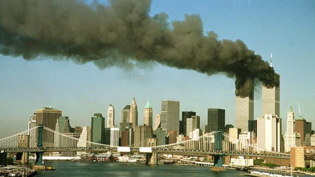 The towers of the World Trade Center pour smoke shortly after being struck by hijacked commercial airplanes in New York in this Sept. 11, 2001, photo.