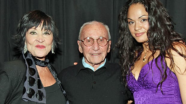 Director Arthur Laurents, centre, is flanked by actress Chita Rivera, left, and actress Karen Olivo while visiting 'West Side Story' At Palace Theater On Broadway on February 26, 2009 in New York City.